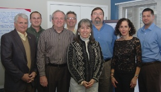 Institute Advisory Council members attending the recent meeting in Annapolis included (L to R) Steve Niswander – Groendyke Transport; Jeff Andrasik – Smithers Rapra; Jim Reilly – GHX; James Dean Vogel – Bioprocess Institute; Debbie Mitchell – NAHAD Standards Manager; Ken Wyatt – TVA; Jo Marie Diamond – E. County Econ. Dev. Corp; and, Standards Committee Chair, Titus Jumper – Campbell Fittings.