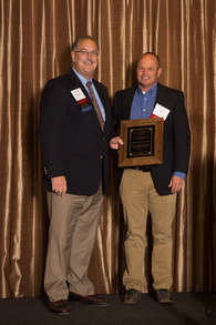 Dr. Bob Broida [left] receives the Bill Hall Award from Dr. Bill Reisinger, who nominated the honoree