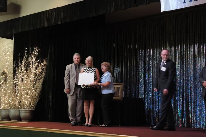 Judy and Doug Peckens present Wall License to Breeci