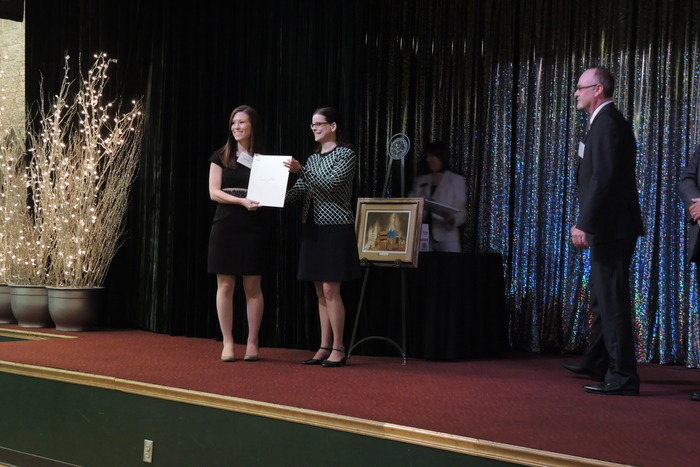 Dee Dee Myers presents Wall License to Cortney Mospan