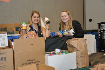 Student pharmacists Larecia Knoerzer and Brittany Schmidt count up the cans of food