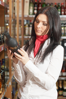 Woman shops for wine